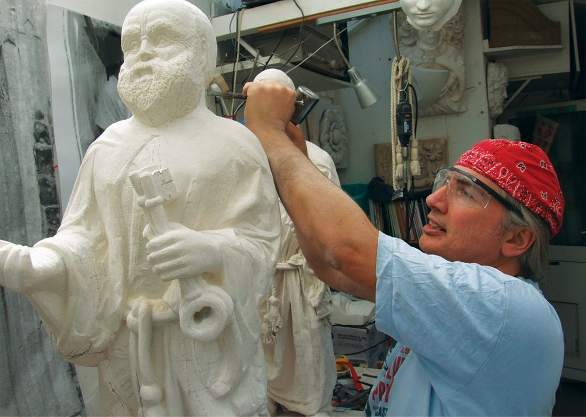 Simon carving the St Peter Statue