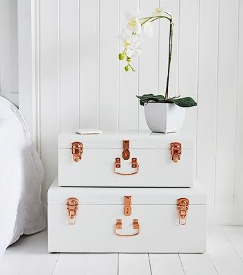 Nantucket white trunks as a bedside table for bedroom furniture