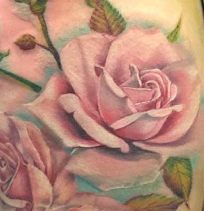 Realistic roses tattoo by Amanda Sissons at Renaissance Tattoo, Rickmansworth
