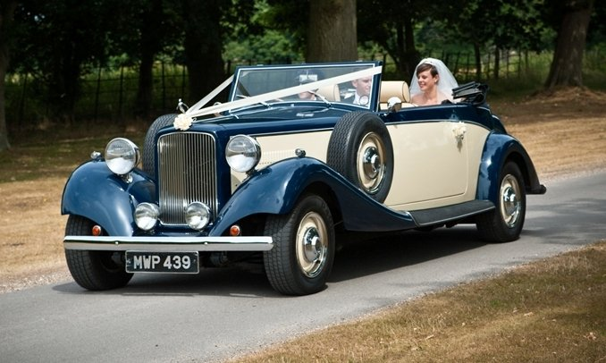 Driving the Bride and Groom to their reception in our Jaguar Drophead