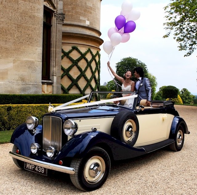 Jaguar drophead with Bride and Groom in car