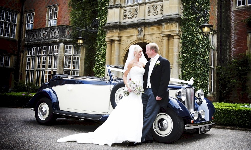 Photographs with the Bride and Groom standing by our Jaguar Drophead