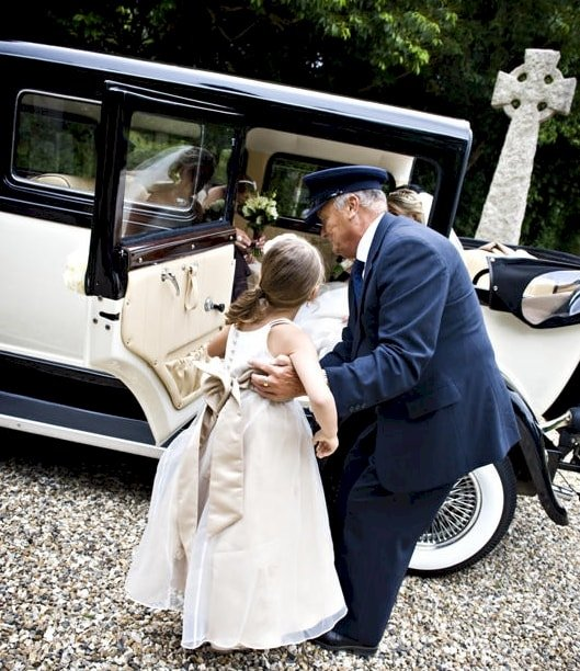 Bramwith Limousine with driver helping Bridesmaids into the car
