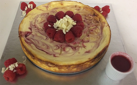 Charlie Thompson's baked cheesecake with raspberry coulis